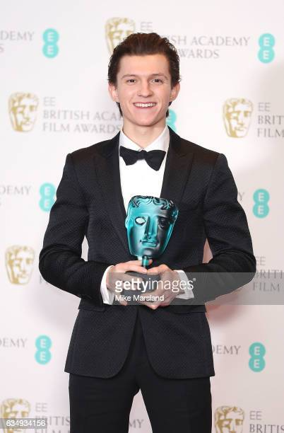 Tom Holland winner of the EE BAFTA Rising Star award poses in the winners room at the 70th EE British Academy Film Awards at Royal Albert Hall on...