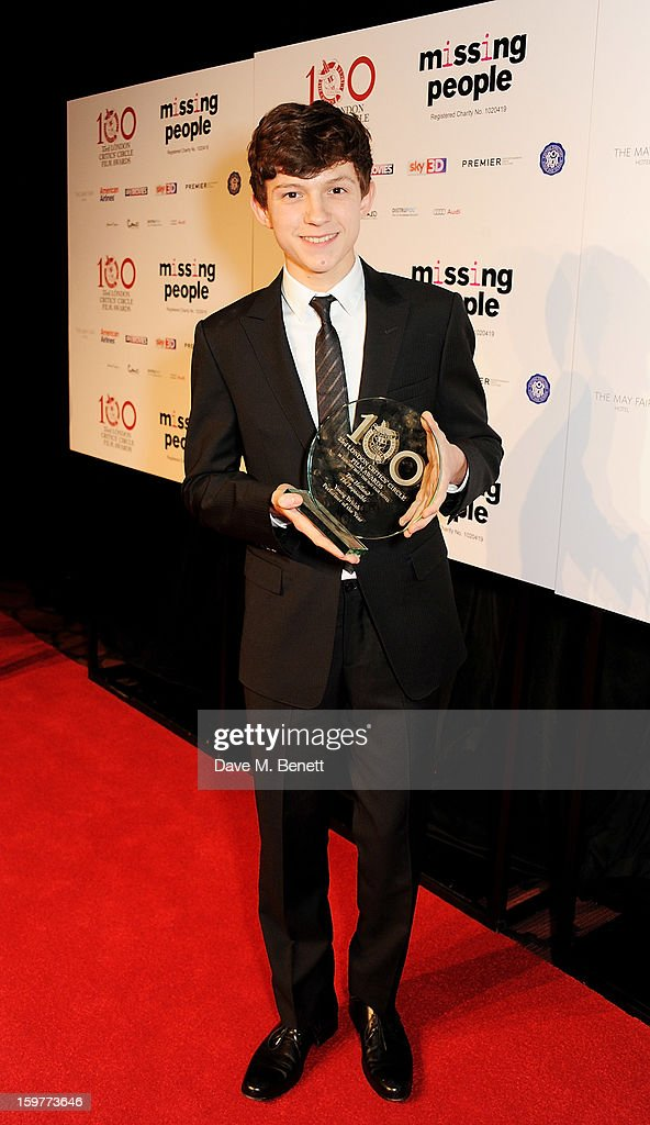 <a gi-track='captionPersonalityLinkClicked' href=/galleries/search?phrase=Tom+Holland+-+Ator&family=editorial&specificpeople=9843230 ng-click='$event.stopPropagation()'>Tom Holland</a>, winner of Young British Performer of the Year, poses in the press room at The London Critics Circle Film Awards at the May Fair Hotel on January 20, 2013 in London, England.