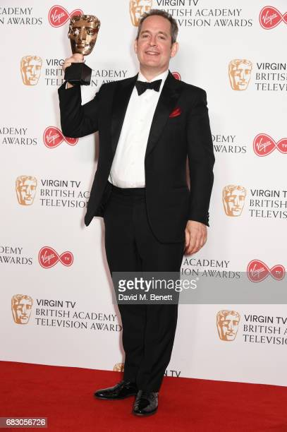 Tom Hollander winner of the Supporting Actor award for 'The Night Manager' poses in the Winner's room at the Virgin TV BAFTA Television Awards at The...