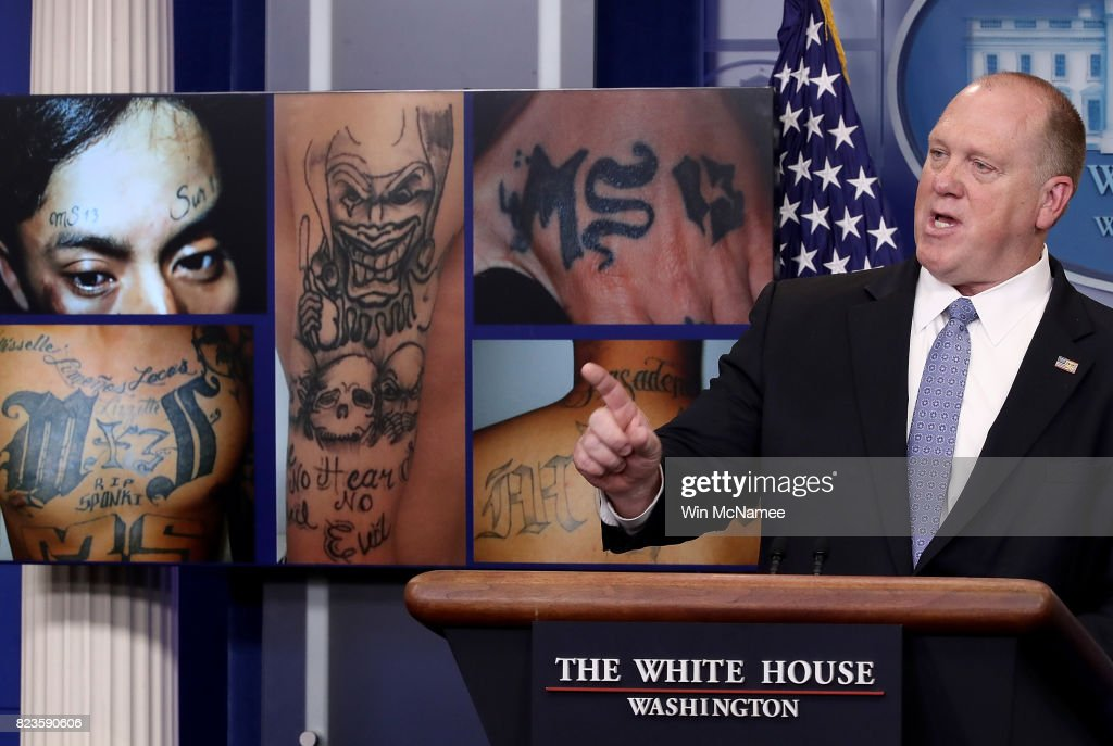 Tom Homan, Director of Immigration and Customs Enforcement, answers questions in front of gang related photos from the MS-13 gang during a daily briefing at the White House July 27, 2017 in Washington, DC. Homan answered a range of questions during the briefing.
