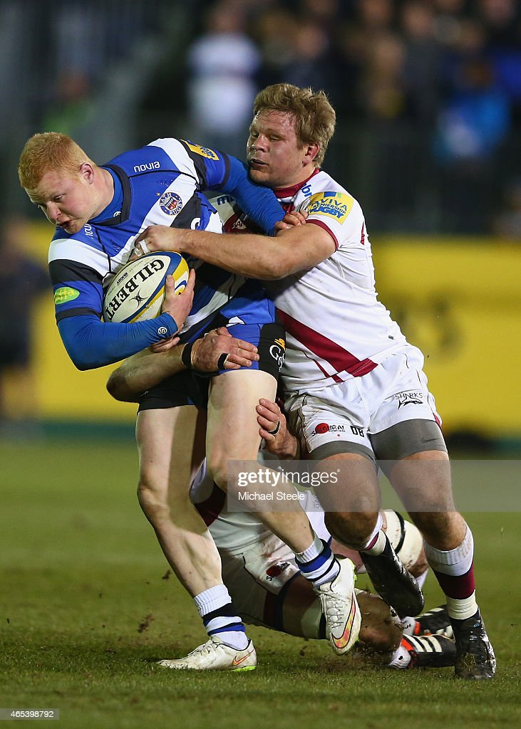 Tom Homer of Bath is held back by Dan Braid of Sale during the Aviva Premiership match between Bath Rugby and Sale at the Recreation Ground on March...