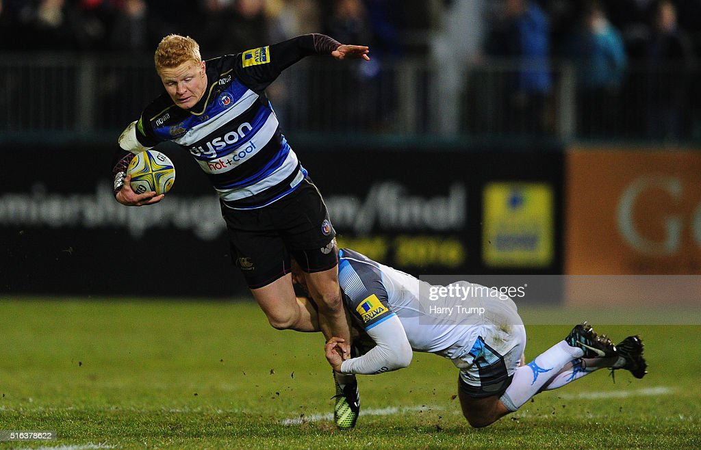 Tom Homer of Bath is tackled by Chris Harris of Newcastle Falcons during the Aviva Premiership match between Bath Rugby and Newcastle Falcons at the...