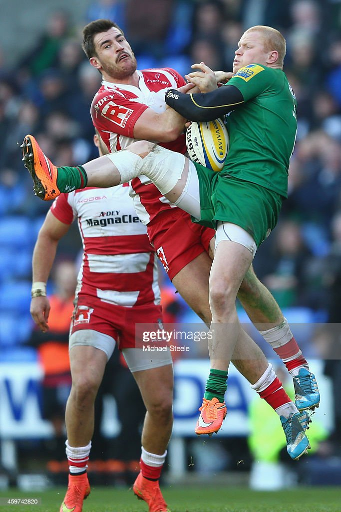 Tom Homer of London Irish and Mark Atkinson of Gloucester challenge for a high ball during the Aviva Premiership match between London Irish and...