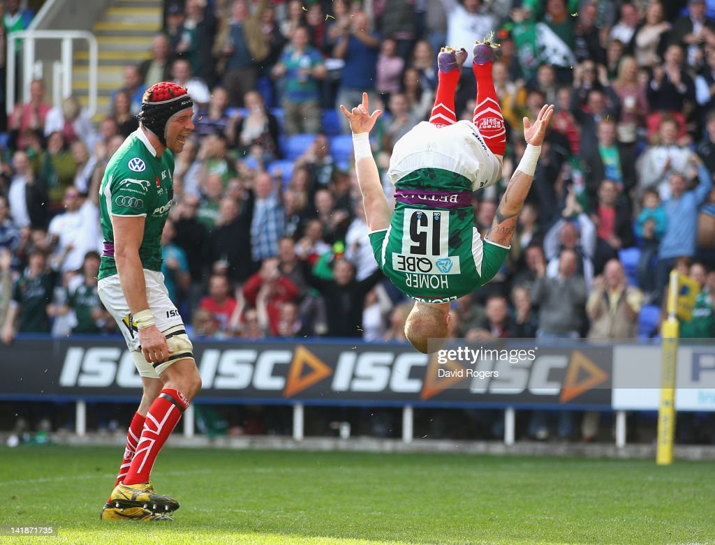 Tom Homer of London Irish celebrates after scoring a try during the Aviva Premiership match between London Irish and Leicester Tigers at Madejski...