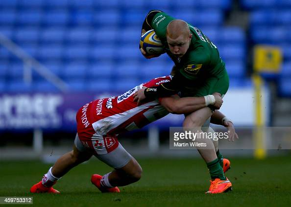Tom Homer of London Irish is tackled by Billy Meakes of Glocuester during the Aviva Premiership match between London Irish and Gloucester Rugby at...