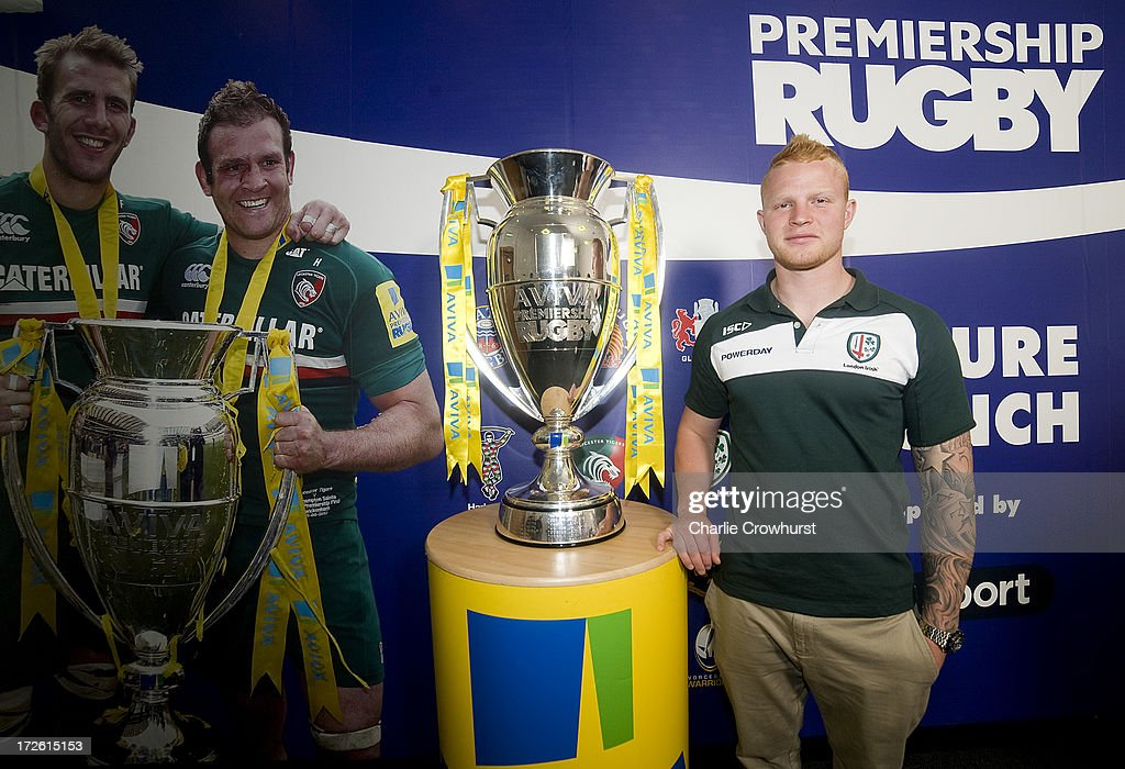 Tom Homer of London Irish stands with the Aviva Premiership Trophy during the 2013-14 Aviva Premiership Rugby Season Fixtures Announcement at The BT Tower on July 4, 2013 in London, England.