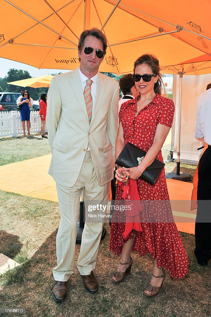 Tom Hooper and Amelia Hungerford attend the Veuve Clicquot Gold Cup final at Cowdray Park Polo Club on July 21, 2013 in Midhurst, England.
