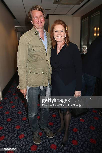 Tom Hooper and Sarah Ferguson pose inside the Royal Box at the 'Chime For Change The Sound Of Change Live' Concert at Twickenham Stadium on June 1...