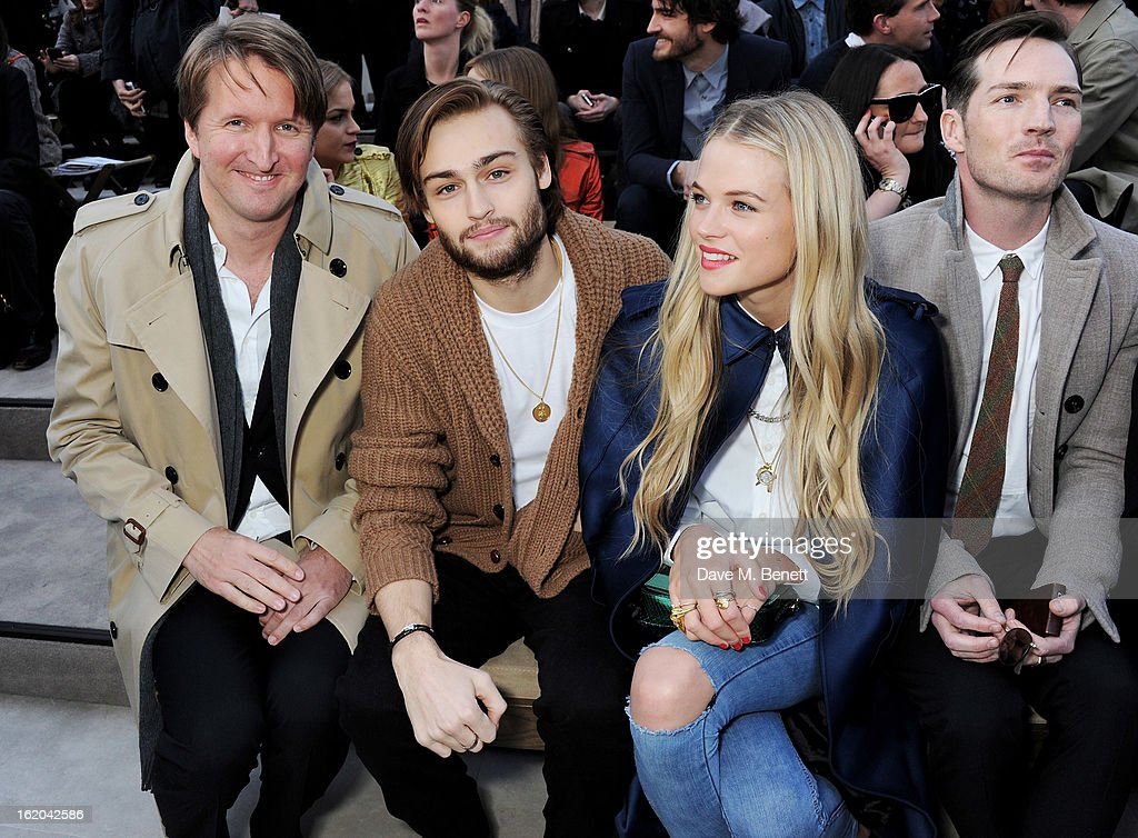Tom Hooper, Douglas Booth, Gabriella Wilde and Dan Gillespie Sells sit in the front row for the Burberry Prorsum Autumn Winter 2013 Womenswear Show at Kensington Gardens on February 18, 2013 in London, England.
