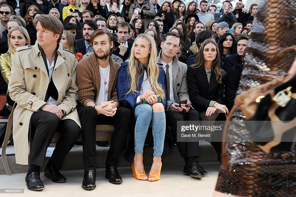 Tom Hooper, Douglas Booth, Gabriella Wilde, Dan Gillespie Sells and Olivia Palermo sit in the front row for the Burberry Prorsum Autumn Winter 2013 Womenswear Show at Kensington Gardens on February 18, 2013 in London, England.