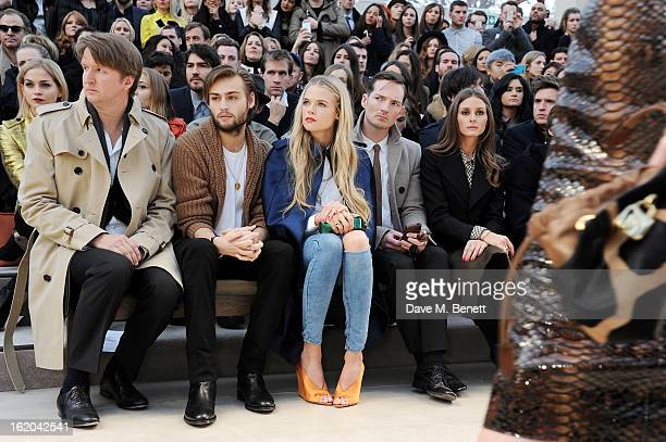 Tom Hooper Douglas Booth Gabriella Wilde Dan Gillespie Sells and Olivia Palermo sit in the front row for the Burberry Prorsum Autumn Winter 2013...