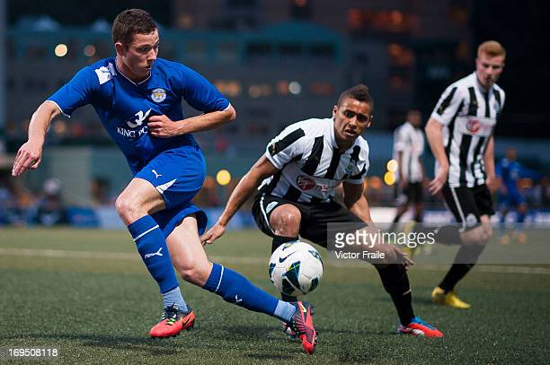 Tom Hopper of Leicester City and James Tavernier of Newcastle United compete for the ball during the final match between Leicester City and Newcastle...