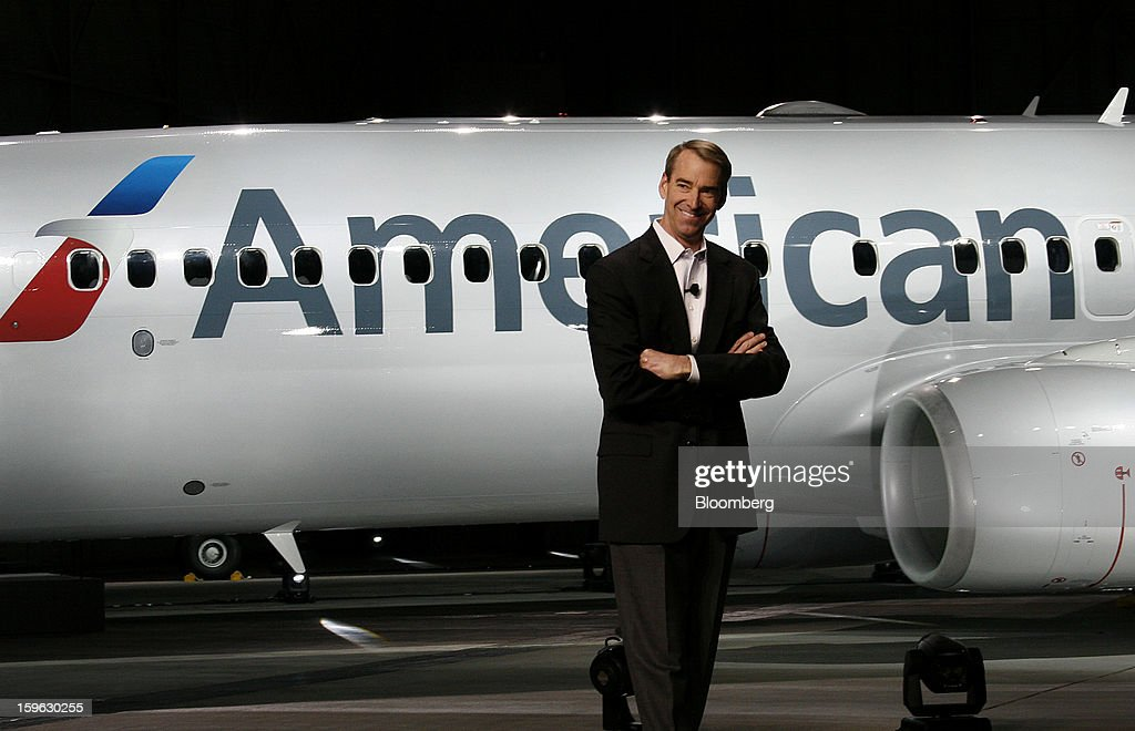 Tom Horton, president and chief executive officer of AMR Corp.'s American Airlines's American Airlines, smiles during an event at Dallas-Fort Worth International Airport in Fort Worth, Texas, U.S., on Thursday, Jan. 17, 2013. American Airlines unveiled the first change in its aircraft livery in more than 40 years as it nears a decision on merging with US Airways Group Inc. or trying to leave bankruptcy on its own. Photographer: Mike Fuentes/Bloomberg via Getty Images