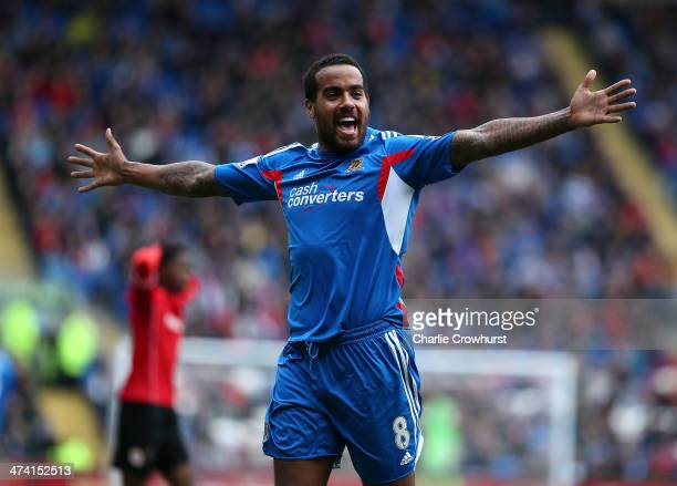 Tom Huddlestone of Hull celebrates after scoring the first goal of the game during the Barclays Premier League match between Cardiff City and Hull...