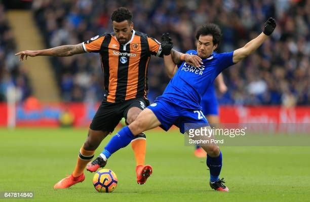Tom Huddlestone of Hull City and Shinji Okazaki of Leicester City battle for possession during the Premier League match between Leicester City and...