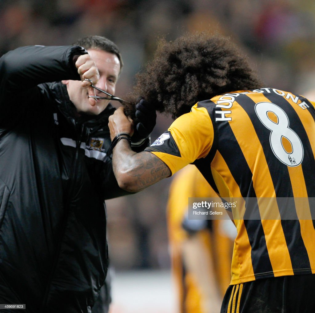 <a gi-track='captionPersonalityLinkClicked' href=/galleries/search?phrase=Tom+Huddlestone&family=editorial&specificpeople=735077 ng-click='$event.stopPropagation()'>Tom Huddlestone</a> of Hull city celebrates after scoring the team's 4th goal by having his hair cut after vowing to not have his hair cut until he scored a goal, during the Barclays Premier League match between Hull City and Fulham at KC stadium on December 28, 2013 in Hull, England.