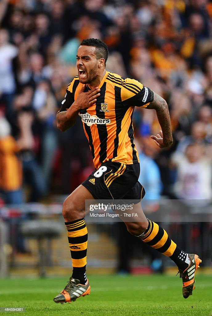 Tom Huddlestone of Hull City celebrates after scoring their third goal during the FA Cup Semi-Final match between Hull City and Sheffield United at Wembley Stadium on April 13, 2014 in London, England.