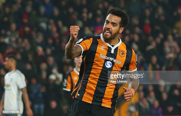 Tom Huddlestone of Hull City celebrates as he scores their first goal from the penalty spot during the EFL Cup SemiFinal second leg match between...