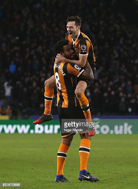Tom Huddlestone of Hull City celebrates his side third goal with Ryan Mason of Hull City during the Premier League match between Hull City and AFC...