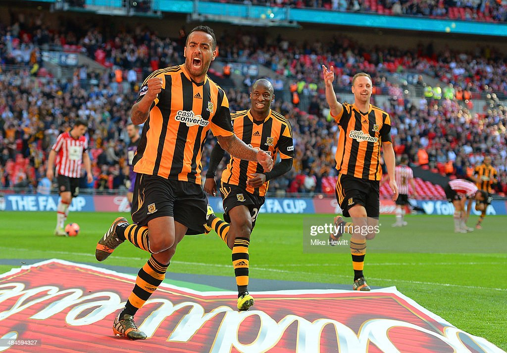 Tom Huddlestone of Hull City celebrates scoring their third goal during the FA Cup with Budweiser semi-final match between Hull City and Sheffield United at Wembley Stadium on April 13, 2014 in London, England.