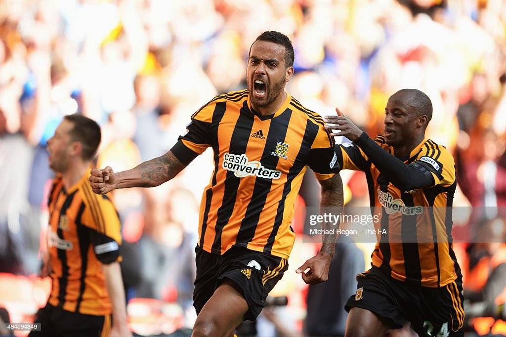 Tom Huddlestone (C) of Hull City celebrates with his team-mate Sone Aluko after scoring their third goal during the FA Cup Semi-Final match between Hull City and Sheffield United at Wembley Stadium on April 13, 2014 in London, England.