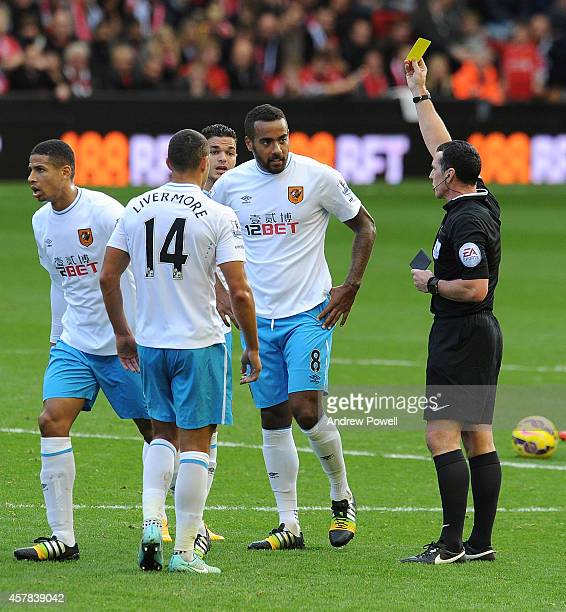 Tom Huddlestone of Hull City is shown the yellow card during the Barclays Premier League match between Liverpool and Hull City at Anfield on October...