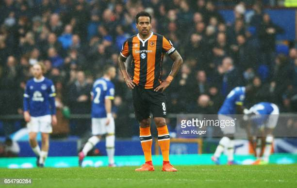 Tom Huddlestone of Hull City looks dejected as Dominic CalvertLewin of Everton scores their first goal during the Premier League match between...