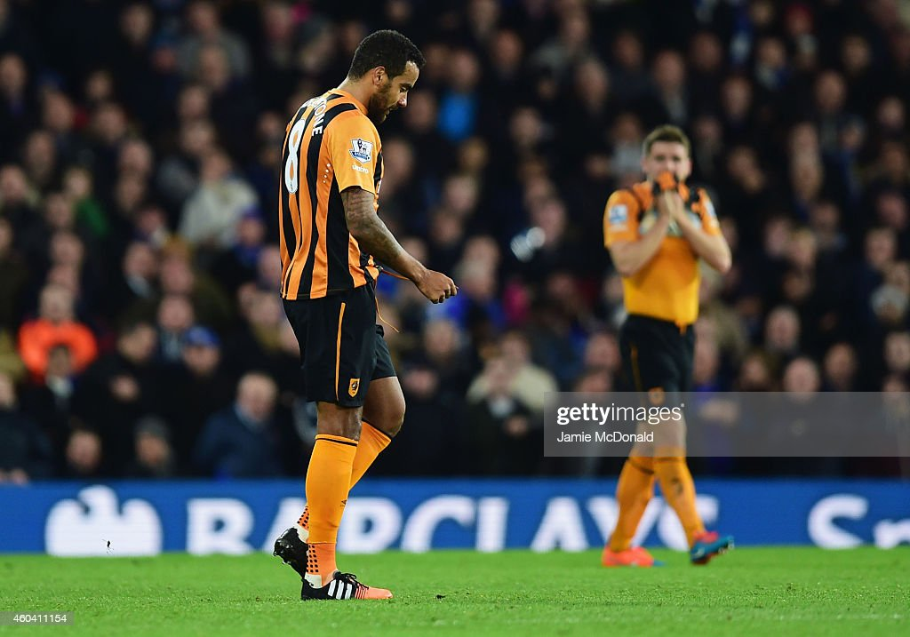 Tom Huddlestone of Hull City (L) looks dejected as he is sent off during the Barclays Premier League match between Chelsea and Hull City at Stamford Bridge on December 13, 2014 in London, England.