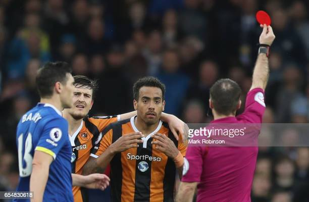 Tom Huddlestone of Hull City reacts as he sent off by referee Paul Tierney during the Premier League match between Everton and Hull City at Goodison...