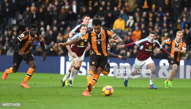 Tom Huddlestone of Hull City scores his sides first goal from the penalty spot during the Premier League match between Hull City and Burnley at KCOM...