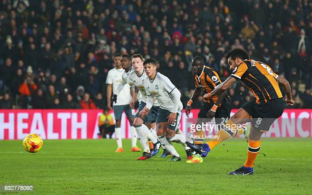 Tom Huddlestone of Hull City scores their first goal from the penalty spot during the EFL Cup SemiFinal second leg match between Hull City and...