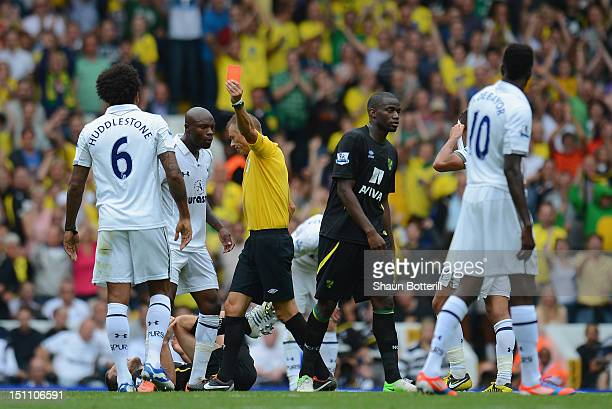 Tom Huddlestone of Tottenham Hotpsur is sent off by referee Mark Halsey during the Barclays Premier League match between Tottenham Hotspur and...