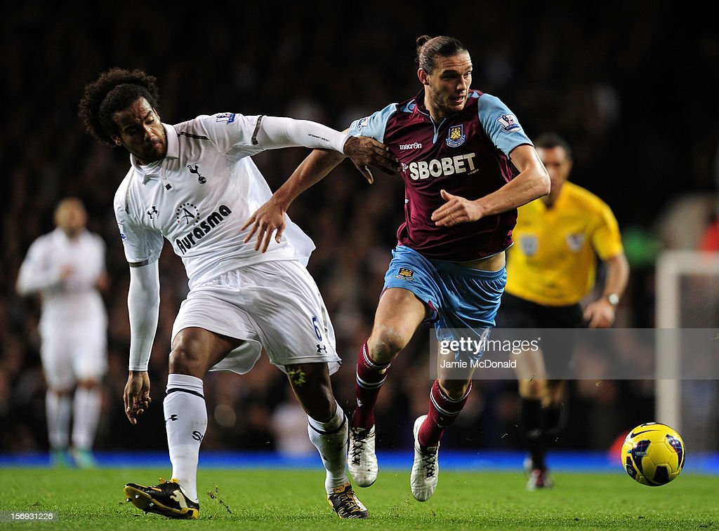 <a gi-track='captionPersonalityLinkClicked' href=/galleries/search?phrase=Tom+Huddlestone&family=editorial&specificpeople=735077 ng-click='$event.stopPropagation()'>Tom Huddlestone</a> of Tottenham Hotspur and <a gi-track='captionPersonalityLinkClicked' href=/galleries/search?phrase=Andy+Carroll+-+Soccer+Player&family=editorial&specificpeople=1449090 ng-click='$event.stopPropagation()'>Andy Carroll</a> of West Ham United battle for the ball during the Barclays Premier League match between Tottenham Hotspur and West Ham United at White Hart Lane on November 25, 2012 in London, England.
