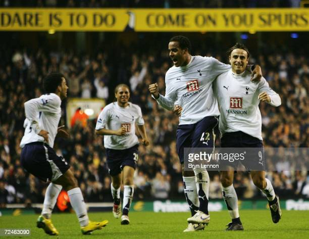 Tom Huddlestone of Tottenham Hotspur celebrates scoring his sides second goal with team mates Aaron Lennon and Dimitar Berbatov during the Carling...