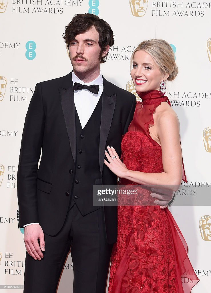 Tom Hughes and Annabelle Wallis pose in the winners room at the EE British Academy Film Awards at the Royal Opera House on February 14, 2016 in London, England.