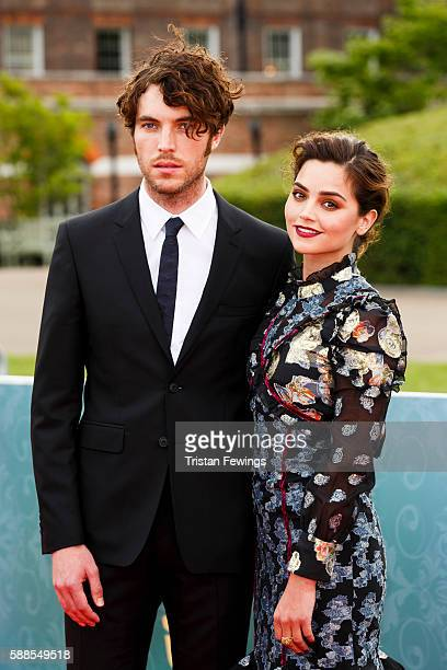 Tom Hughes and Jenna Coleman arrive for the premiere screening of ITV's Victoria at The Orangery on August 11 2016 in London England