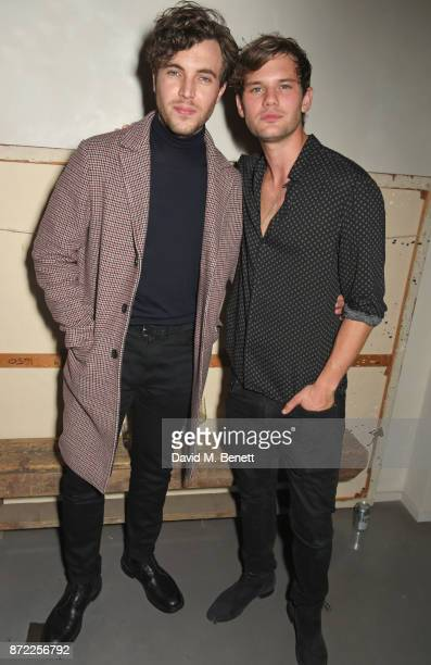 Tom Hughes and Jeremy Irvine attend the launch of the MR PORTER own label Mr P on November 9 2017 in London England