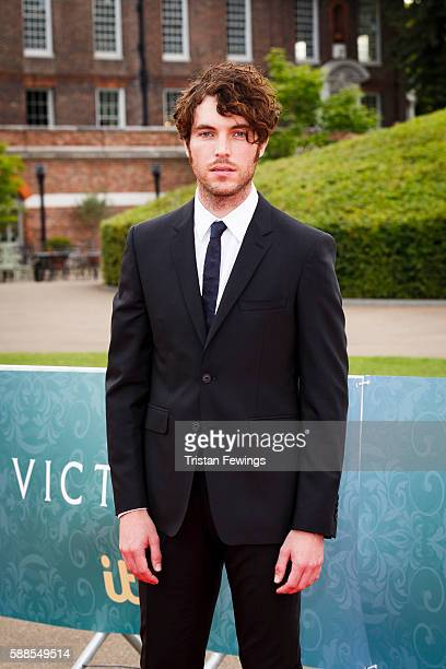Tom Hughes arrives for the premiere screening of ITV's Victoria at The Orangery on August 11 2016 in London England