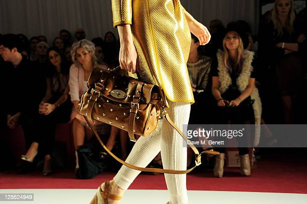 Tom Hughes Olivia Palmero Marina Diamandis a model and Marissa Montgomery sit in the front row at the Mulberry Spring/Summer 2012 runway show during...