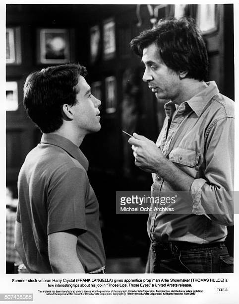 Tom Hulce listens to tips from Frank Langella in a scene from the United Artist movie 'Those Lips Those Eyes' circa 1980