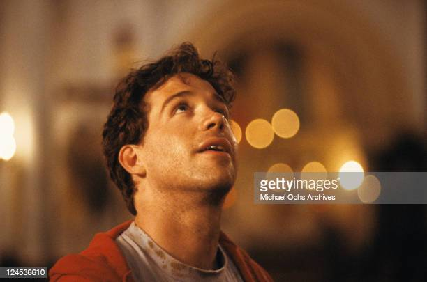 Tom Hulce looking up in a scene from the film 'Dominick And Eugene' 1988