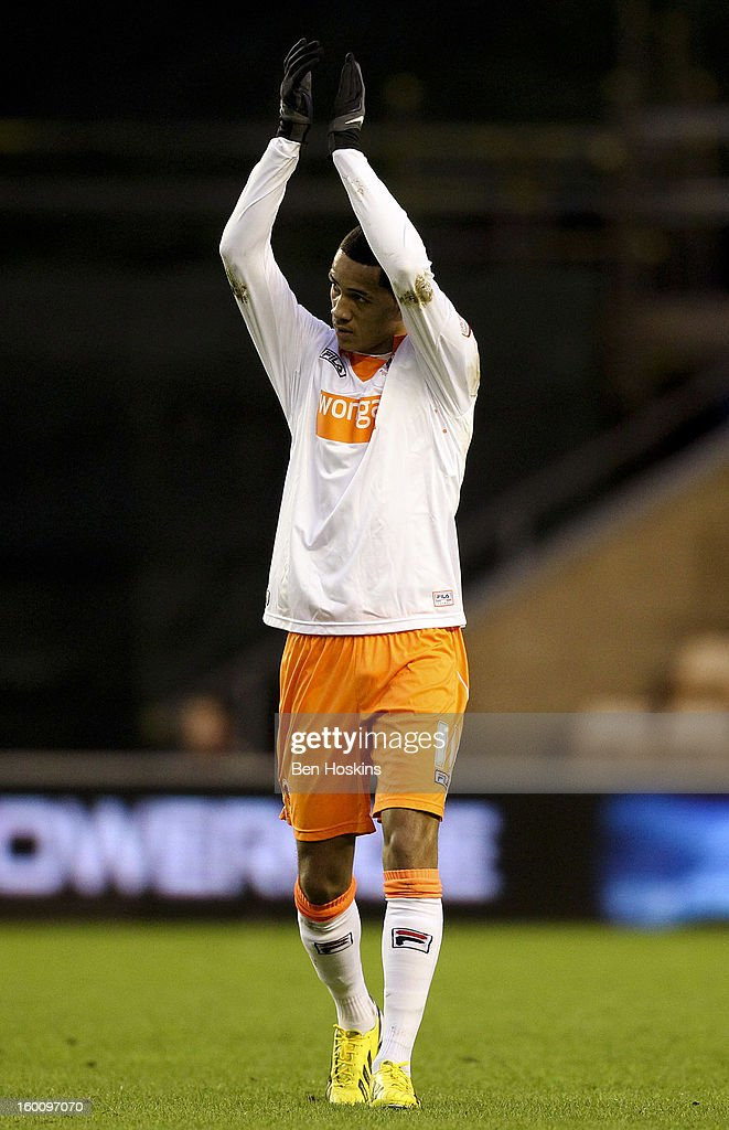 Tom Ince of Blackpool applauds the travelling support during the npower Championship match between Wolverhampton Wanderers and Blackpool at Molineux on January 24, 2013 in Wolverhampton, England.