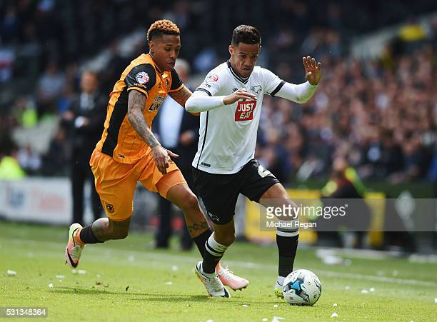 Tom Ince of Derby County is chased by Abel Hernandez of Hull City during the Sky Bet Championship Play Off semi final first leg match between Derby...