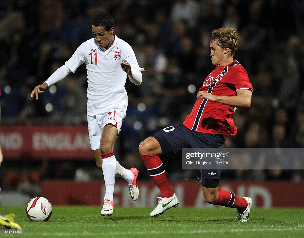 Tom Ince of England and Thomas Rogne (R) of Norway compete for the ball during the UEFA Under 21 Championship match between England and Norway at the B2NET Stadium on September 10, 2012 in Chesterfield, England