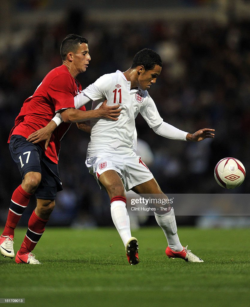 Tom Ince (R) of England shields the ball from Omar Elabdellaoui of Norway during the UEFA Under 21 Championship match between England and Norway at the B2NET Stadium on September 10, 2012 in Chesterfield, England