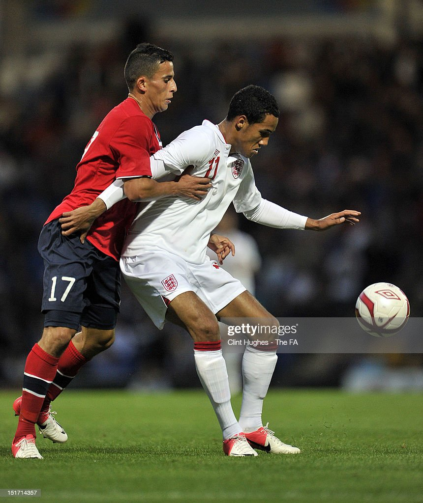 Tom Ince (R) of England shields the ball from Omar Elabdellaoui (L) of Norway during the UEFA Under 21 Championship match between England and Norway at the B2NET Stadium on September 10, 2012 in Chesterfield, England