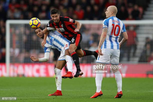 Tom Ince of Huddersfield Town and Andrew Surman of AFC Bournemouth compete for the ball during the Premier League match between AFC Bournemouth and...