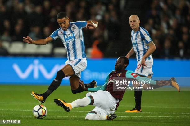 Tom Ince of Huddersfield Town and Pedro Mba Obiang of West Ham United during the Premier League match between West Ham United and Huddersfield Town...
