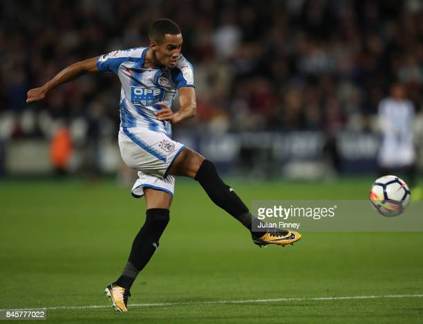 Tom Ince of Huddersfield Town has a shot at goal during the Premier League match between West Ham United and Huddersfield Town at London Stadium on...