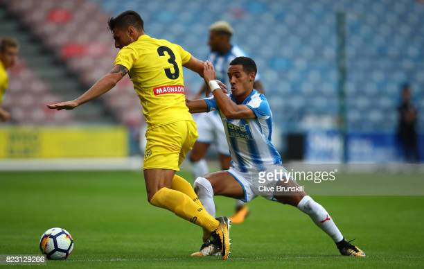 Tom Ince of Huddersfield Town in action with Giuseppe Pezzella Udinese during the pre season friendly match between Huddersfield Town and Udinese at...
